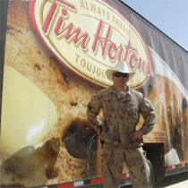 WO Turner hams it up as he waits for Timmy's to open at the base in Kandahar